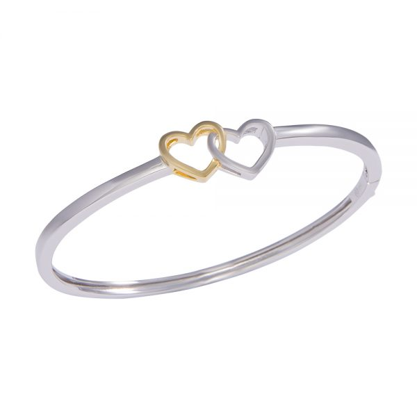 Two tone silver bangle with two heart intertwined